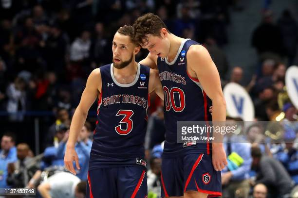 Jordan Ford and Tanner Krebs of the Saint Mary's Gaels react after being defeated by the Villanova Wildcats during the first round of the 2019 NCAA...