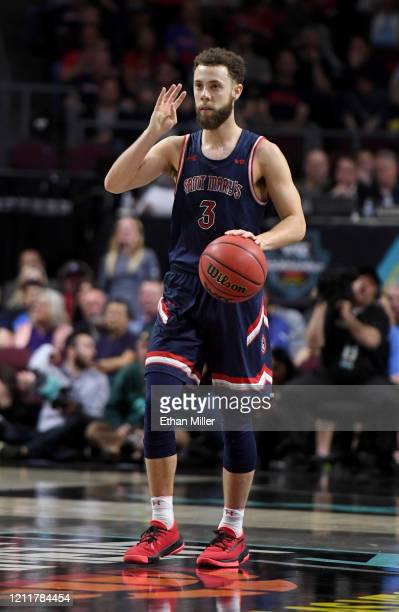 Jordan Ford of the Saint Mary's Gaels brings the ball up the court against the Gonzaga Bulldogs during the championship game of the West Coast...