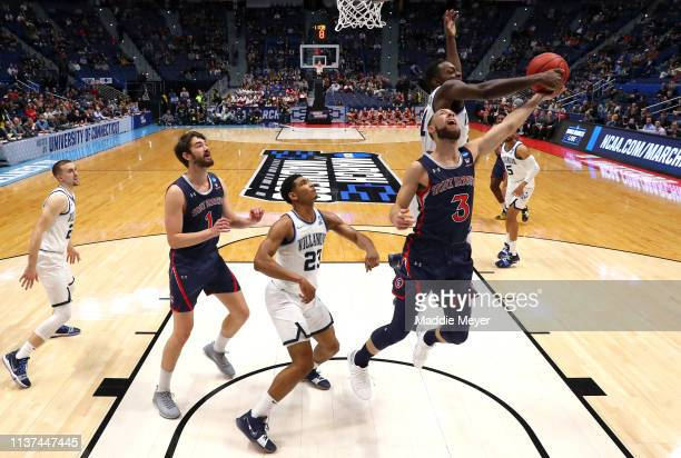 Jordan Ford of the Saint Mary's Gaels drives to the basket against Dhamir CosbyRoundtree of the Villanova Wildcats in the first half during the first...