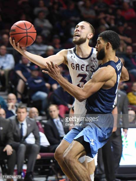 Jordan Ford of the Saint Mary's Gaels is fouled as he drives to the basket against Isaiah Wright of the San Diego Toreros during a semifinal game of...
