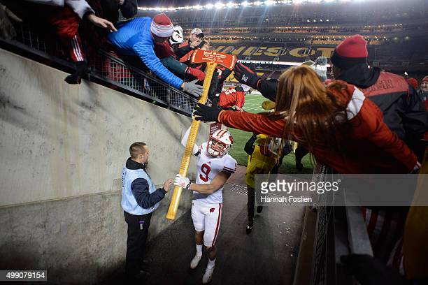 Jordan Fredrick of the Wisconsin Badgers carries Paul Bunyan's Axe off the field after a win of the game against the Minnesota Golden Gophers on...