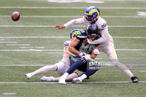 Jordan Fuller and Justin Hollins of the Los Angeles Rams break up a pass intended for Greg Olsen of the Seattle Seahawks in the second quarter at...