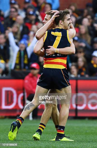 Jordan Gallucci of the Adelaide Crows celebrates a goal during the round 22 AFL match between the Adelaide Crows and North Melbourne Kangaroos at...