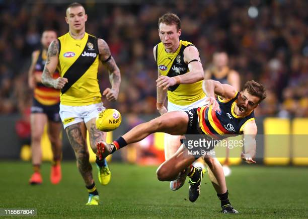 Jordan Gallucci of the Adelaide Crows falls from a mark attempt in front of Josh Caddy of the Tigers during the round 13 AFL match between the...