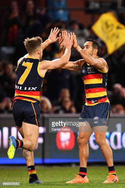 Jordan Gallucci of the Crows and Eddie Betts of the Crows celebrates after kicking a goal during the round 17 AFL match between the Adelaide Crows...