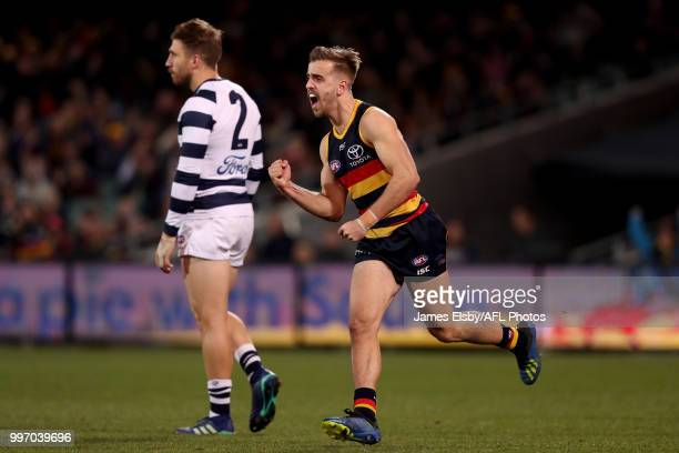 Jordan Gallucci of the Crows celebrates a goal during the 2018 AFL round 17 match between the Adelaide Crows and the Geelong Cats at Adelaide Oval on...