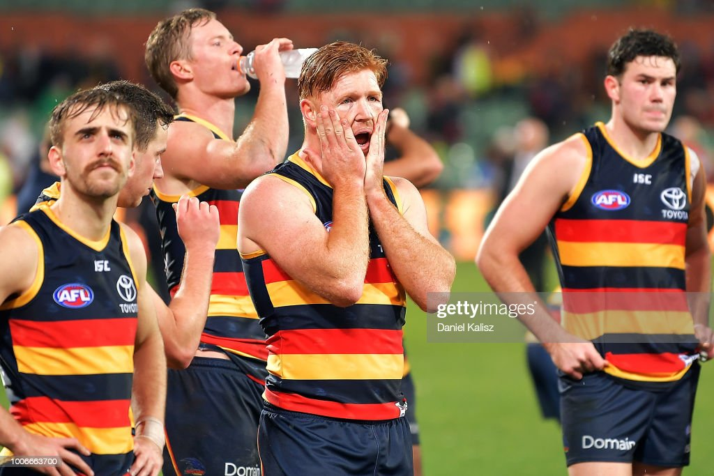 Jordan Gallucci of the Crows, Kyle Cheney of the Crows and Mitch McGovern of the Crows look on dejected after the round 19 AFL match between the Adelaide Crows and the Melbourne Demons at Adelaide Oval on July 28, 2018 in Adelaide, Australia.