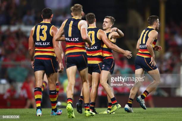 Jordan Galluci of the Crows celebrates kicking a goal with team mates during the round five AFL match between the Sydney Swans and the Adelaide Crows...