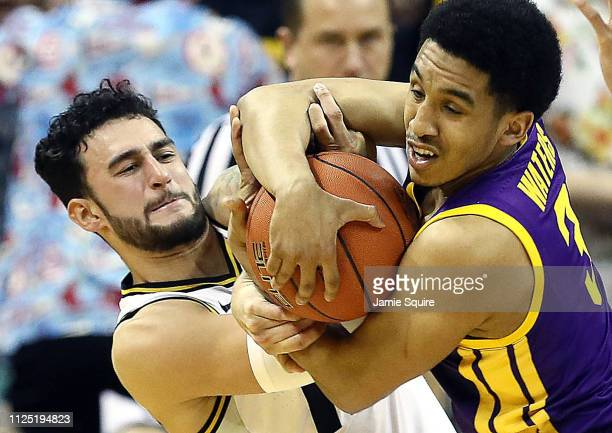 Jordan Geist of the Missouri Tigers and Tremont Waters of the LSU Tigers wrestle for the ball during the game at Mizzou Arena on January 26 2019 in...