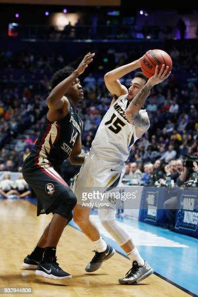 Jordan Geist of the Missouri Tigers is defended by Terance Mann of the Florida State Seminoles during the game in the first round of the 2018 NCAA...
