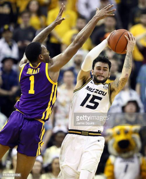 Jordan Geist of the Missouri Tigers looks to pass as Ja'vonte Smart of the LSU Tigers defend during the game at Mizzou Arena on January 26 2019 in...