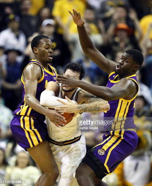 Jordan Geist of the Missouri Tigers tries to control the ball as Ja'vonte Smart and Darius Days of the LSU Tigers defend during the game at Mizzou...