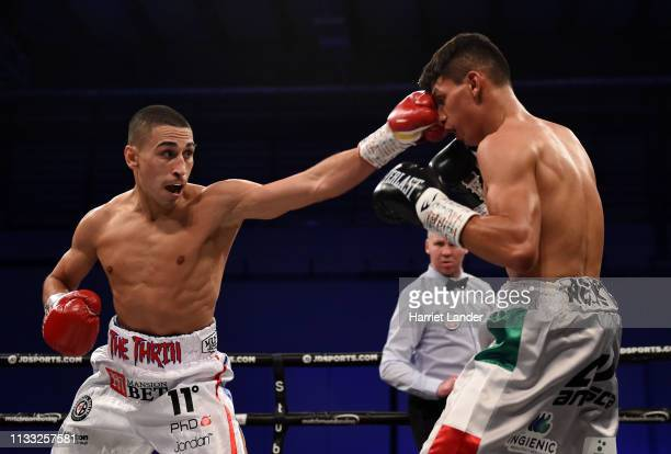Jordan Gill punches Emmanuel Dominguez during the WBA International Featherweight Championship fight between Jordan Gill and Emmanuel Dominguez on...