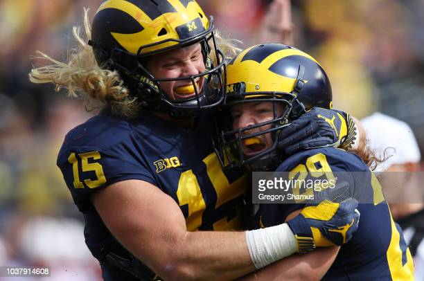Jordan Glasgow and Chase Winovich of the Michigan Wolverines celebrate a first half sack while playing the Nebraska Cornhuskers on September 22 2018...