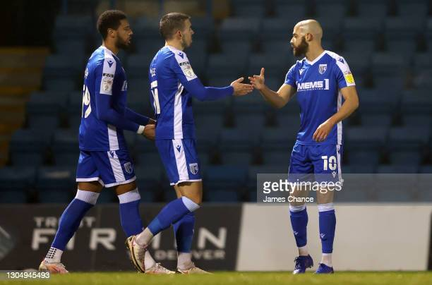 Jordan Graham of Gillingham FC celebrates with Vadaine Oliver and Oliver Lee after scoring his sides first goal during the Sky Bet League One match...