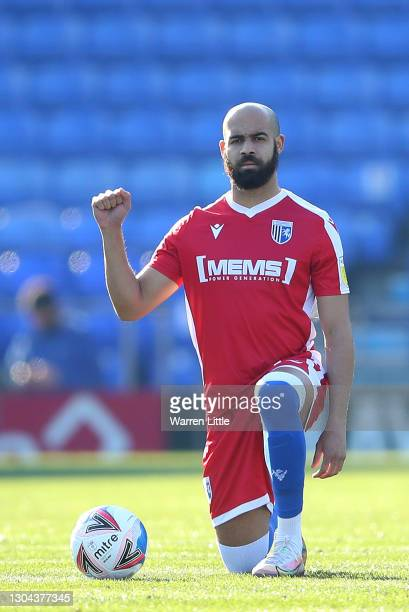 Jordan Graham of Gillingham FC takes a knee ahead of the Sky Bet League One match between Portsmouth and Gillingham at Fratton Park on February 27,...