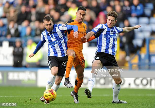 Jordan Graham of Wolverhampton Wanderers with Jack Hunt of Sheffield Wednesday and Sam Hutchinson of Sheffield Wednesday during the Sky Bet...
