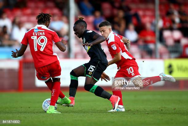 Jordan Green of Yeovil Town tackles with Dean Cox and Cedric Evina of Crawley Town during the Sky Bet League Two match between Crawley Town and...