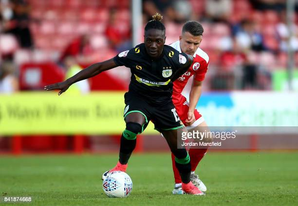Jordan Green of Yeovil Town tackles with Dean Cox of Crawley Town during the Sky Bet League Two match between Crawley Town and Yeovil Town at...