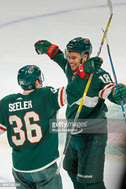 Jordan Greenway celebrates his goal with teammate Nick Seeler of the Minnesota Wild against the Winnipeg Jets in Game Three of the Western Conference...