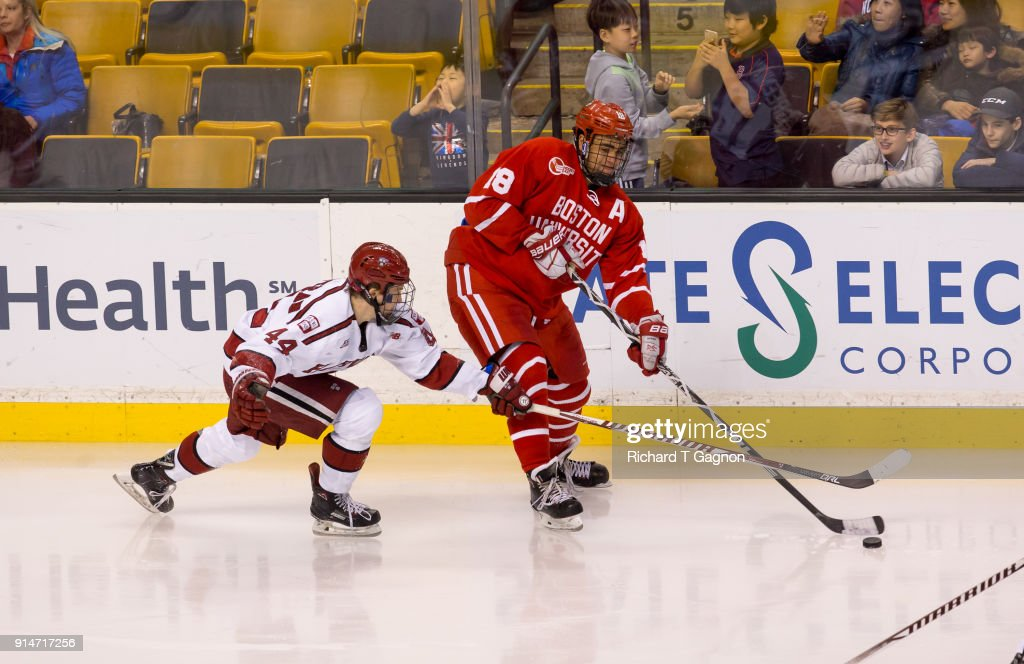 Jordan Greenway #18 of the Boston University Terriers skates against Michael Floodstrand #44 of the Harvard Crimsonduring NCAA hockey in the semifinals of the annual Beanpot Hockey Tournament at TD Garden on February 5, 2018 in Boston, Massachusetts. The Terriers won 3-2 in double overtime.