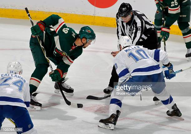 Jordan Greenway of the Minnesota Wild and J.T. Miller of the Tampa Bay Lightning face-off during a game between the Minnesota Wild and Tampa Bay...