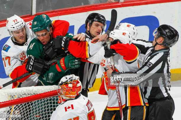 Jordan Greenway of the Minnesota Wild and Mark Giordano of the Calgary Flames have to be separated during the game at the Xcel Energy Center on...