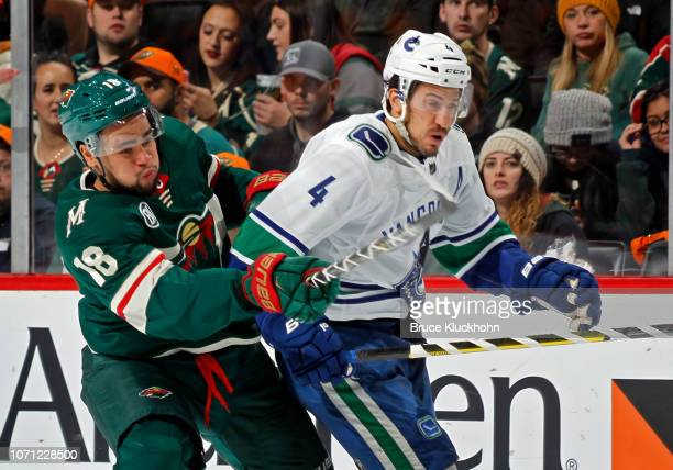 Jordan Greenway of the Minnesota Wild battles with Michael Del Zotto of the Vancouver Canucks during a game at Xcel Energy Center on November 15,...