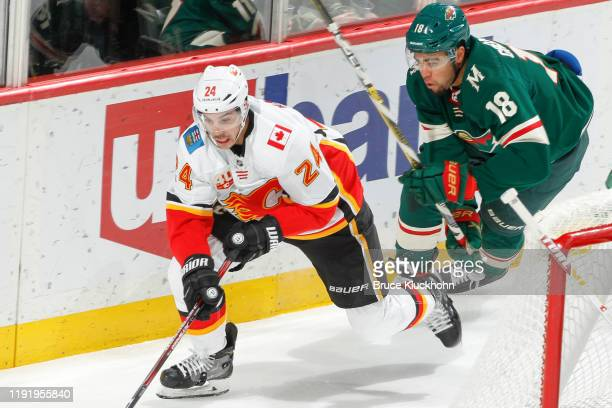 Jordan Greenway of the Minnesota Wild defends Travis Hamonic of the Calgary Flames during the game at the Xcel Energy Center on January 5, 2020 in...