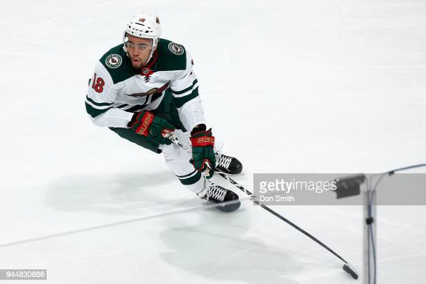 Jordan Greenway of the Minnesota Wild handles the puck during a NHL game against the San Jose Sharks at SAP Center on April 7 2018 in San Jose...