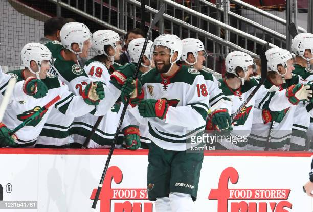Jordan Greenway of the Minnesota Wild is congratulated by teammates after scoring a goal against the Arizona Coyotes during the second period of the...