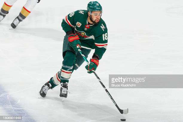 Jordan Greenway of the Minnesota Wild skates with the puck against the Vegas Golden Knights during the game at the Xcel Energy Center on March 8,...
