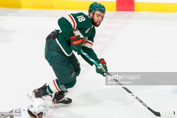 Jordan Greenway of the Minnesota Wild skates with the puck against the Vegas Golden Knights during Game Three of the First Round of the 2021 Stanley...