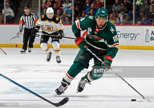 Jordan Greenway of the Minnesota Wild skates with the puck during a game with the Boston Bruins at Xcel Energy Center on April 4, 2019 in St. Paul,...