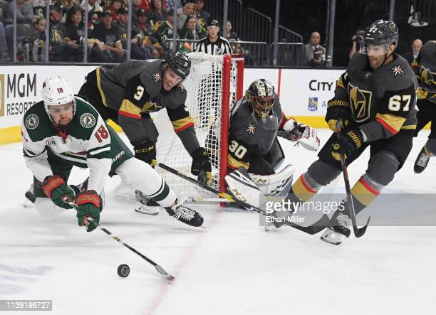 Jordan Greenway of the Minnesota Wild skates with the puck under pressure from Brayden McNabb and Max Pacioretty of the Vegas Golden Knights as...