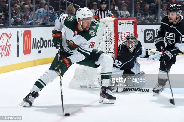 Jordan Greenway of the Minnesota Wild skates with the puck who Jonathan Quick and Alec Martinez of the Los Angeles Kings protect the goal during the...
