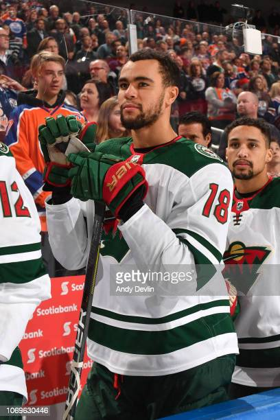 Jordan Greenway of the Minnesota Wild stands for the singing of the national anthem prior to the game against the Edmonton Oilers on December 7, 2018...