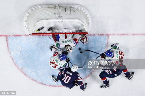 Jordan Greenway of USA and Luca Zanatta of Italy fight for the puck with Anders Bjork of USA, Simon Kostner of Italy and goal keeper Andreas Bernard...