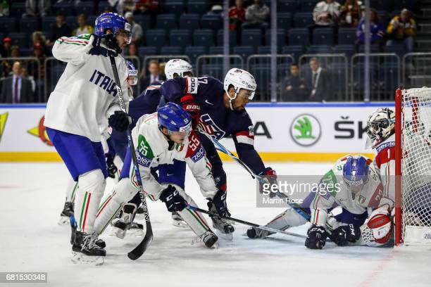 Jordan Greenway of USA tries to score against Andreas Bernard goalkeeper of Italy during the 2017 IIHF Ice Hockey World Championship game between USA...