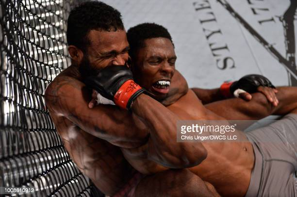 Jordan Griffin secures a rear choke submission against Maurice Mitchell in their featherweight fight during Dana White's Tuesday Night Contender...