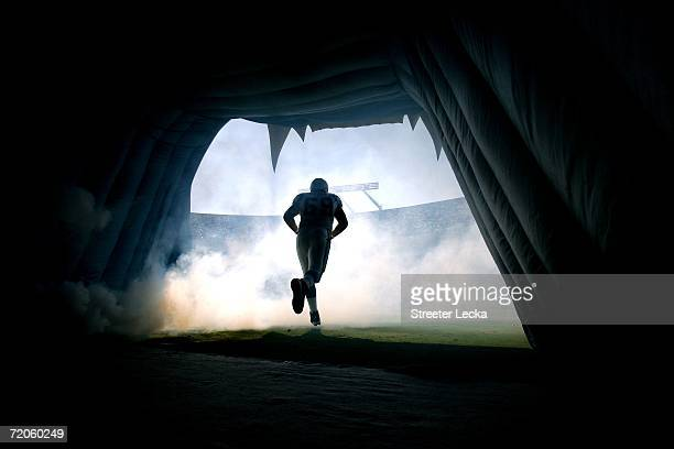Jordan Gross of the Carolina Panthers runs onto the field before the start of their game against the New Orleans Saints on October 1, 2006 at Bank of...