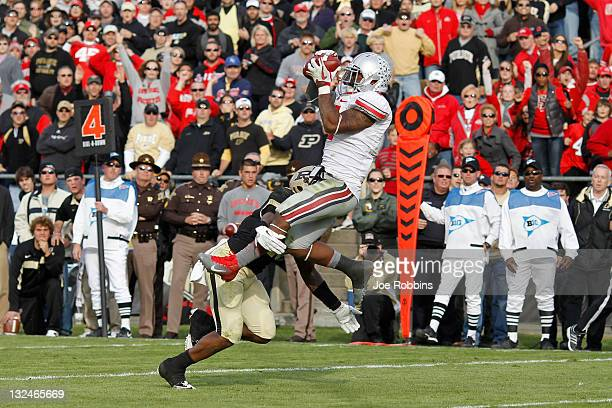 Jordan Hall of the Ohio State Buckeyes makes a 13yard touchdown reception in the fourth quarter to tie the game against the Purdue Boilermakers at...