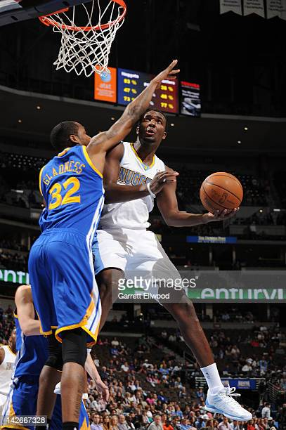 Jordan Hamilton of the Denver Nuggets drives to the basket against Mickell Gladness of the Golden State Warriors on April 9, 2012 at the Pepsi Center...