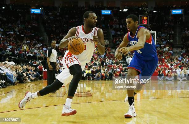 Jordan Hamilton of the Houston Rockets drives with the ball against Hollis Thompson of the Philadelphia 76ers during the game at the Toyota Center on...