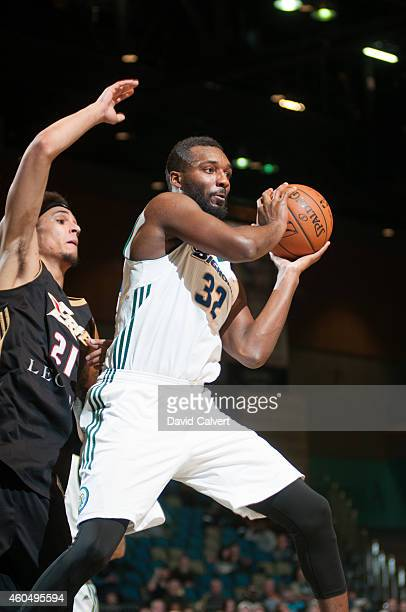 Jordan Hamilton of the Reno Bighorns passes to a teammate guarded by John Bohannon of the Erie BayHawks during an NBA DLeague game on December 14...