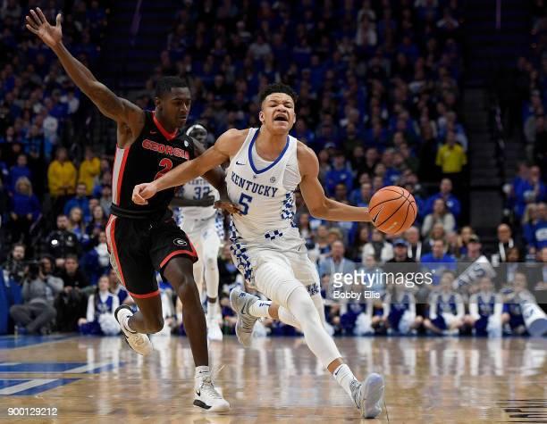 Jordan Harris of the Georgia Bulldogs defends against Kevin Knox of the Kentucky Wildcats as he runs the ball downcourt during the first half of the...