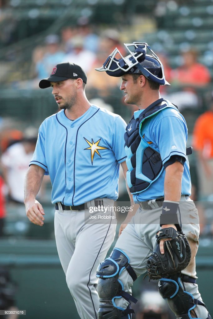 Jordan Harrison #76 and Nick Ciuffo #72 of the Tampa Bay Rays celebrate after the final out against the Baltimore Orioles during a Grapefruit League spring training game at Ed Smith Stadium on February 23, 2018 in Sarasota, Florida. The Rays won 6-3.