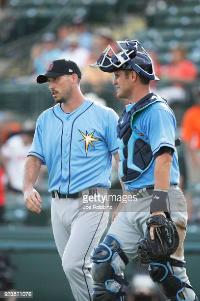 Jordan Harrison and Nick Ciuffo of the Tampa Bay Rays celebrate after the final out against the Baltimore Orioles during a Grapefruit League spring...