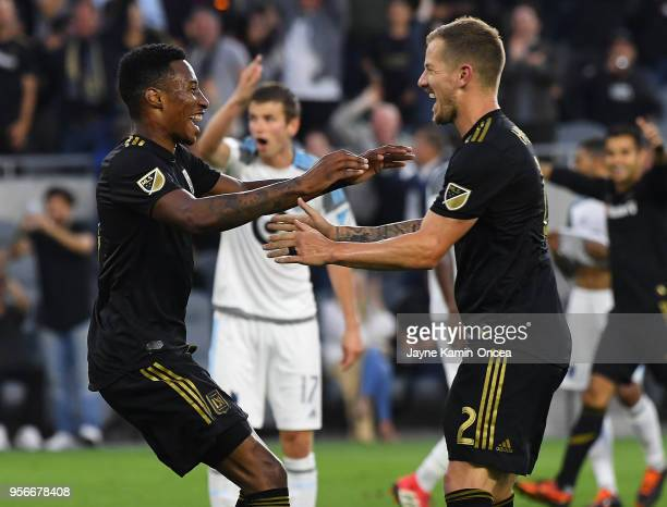 Jordan Harvey of Los Angeles FC celebrates with MarkAnthony Kay of the Los Angeles FC after he scored a goal in the first half of the game against...