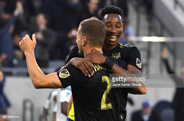 Jordan Harvey of Los Angeles FC celebrates with MarkAnthony Kaye of Los Angeles FC after his first MLS goal in the game against the Minnesota United...